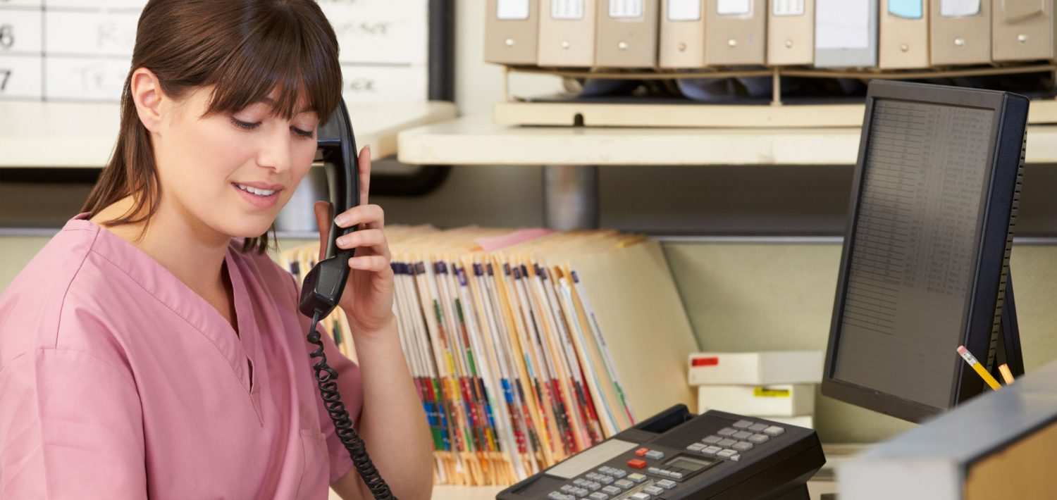 medical billing specialist on the phone with a patient - Medical Information Specialist